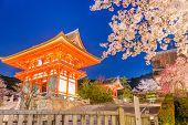 Kyoto, Japan at Kiyomizu-dera Temples Niomon gate during spring season. (signs read: Niomon Gate) poster