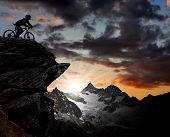 silhouette of a biker in the Swiss Alps