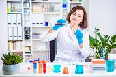 Girl Scientist Or Researcher Researching In The Laboratory. Different Reagent Flasks And Test Tubes  poster