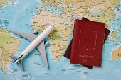 Airplane And Two Passports Travel Documents On The Map Of The World, Holidays Abroad. Plane Worldwid poster