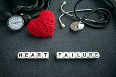 Word Heart Failure From White Cubes With Letters On Dark Background With Red Thread Heart And Tonome poster