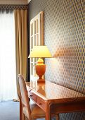 interior luxury apartment, detail room, table lamp and wooden desk