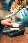 Man Using Payment Terminal. White Credit Card. Hand Use Credit Card. Bar Table. The Beer Taps In A P poster