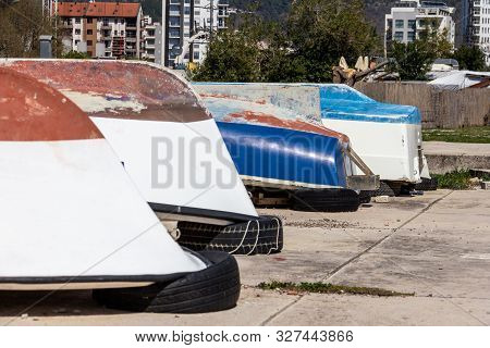 poster of Boats Being Stored Upside Down On A Sidewalk Near Old Town Budva, Montenegro