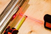 Measuring with tapemeasure tool and red laser beam