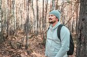 Hiker - Man Hiking In Forest. Male Hiker Looking To The Side Walking In Forest. Caucasian Male Model poster