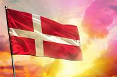 Fluttering Denmark Flag On Beautiful Colorful Sunset Or Sunrise Background. Denmark Success And Happ poster