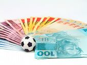 Brazilian currency notes and soccer ball