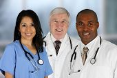stock photo of nurse practitioner  - Group of doctors and nurses set in a hospital - JPG