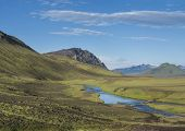 Beautiful Green Hills, Lush Grass And Blue River With Footbridge Next To Camping Site On Alftavatn L poster