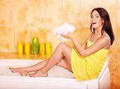 Young  beautiful woman take bubble  bath.