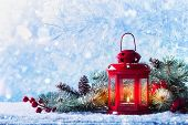 Christmas Lantern In Snow With Fir Tree Branch. Winter Cozy Scene. poster