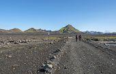 Icelandic Lava Desert Landscape With Two Man Hikers Crossing Footbridge On Innri-emstruraon On Lauga poster