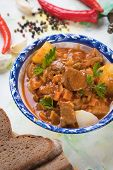 Hungarian goulash, pork or beef stew served in round bowl poster