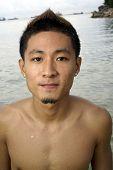 Young Chinese Asian Man At Beach
