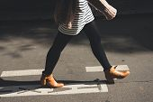 Woman Legs Walk On Street. Woman Legs Walk On Street In Brown Shoes. Woman Legs Side View. Close Up  poster