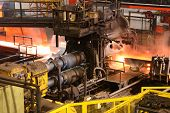 picture of water-mill  - Steel rolling mill in action with water cooling and high temperatures - JPG