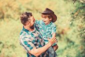 Rustic Family. Growing Cute Cowboy. Small Helper In Garden. Little Boy And Father In Nature Backgrou poster