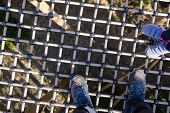 Feet Of Two People, Urecognizable, Standing On Suspended Walkway Safety Net, Playgound Safety, Adven poster