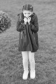 Girl Cute Face Braided Hair Posing Coat In Spring Park. Clothing For Spring Walks. Little Fashion Mo poster