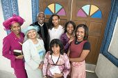 stock photo of pre-adolescent child  - African American Reverend and parishioners in front of church - JPG