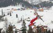 BUKOVEL, UKRAINE - FEBRUARY 23: Mischa Gasser, Switzerland performs aerial skiing during Freestyle Ski World Cup in Bukovel, Ukraine on February 23, 2013.