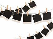 Blank Photo Frames On A Rope. 3D Render