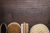 some bath accessories on wooden background