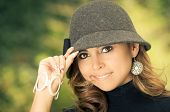 stock photo of post-teen  - Beautiful young woman in a fashion pose with a hat - JPG