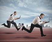 stock photo of leadership  - Conceot of competition with two running businessman in a track - JPG