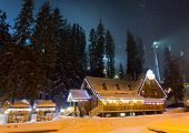 Beautiful ski chalet at night