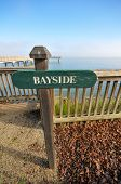 Bayside Sign Near A Pier Over Water