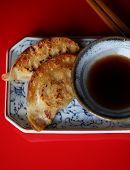 Gyoza Dumplings on Japanese Plate with Chopsticks