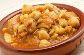 foto of tripe  - Casserole typical tripe with chickpeas Spain surrounded by white background - JPG