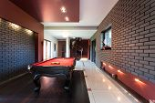 foto of snooker  - Snooker table in a luxury interior with brick walls - JPG
