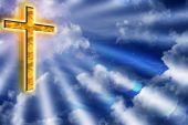 Golden Cross In Cloudy Blue Sky