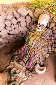 stock photo of unexplained  - Embalmed mummy and skull in Peru - JPG