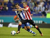 BARCELONA - SEP, 23: Iker Muniain(R) of Bilbao vies with Stuani(L) of Espanyol during a Spanish Leag