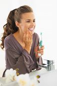 Portrait Of Young Woman Checking Teeth After Brushing