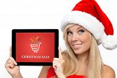 Girl In A Red Christmas Hat On New Year Holding Tablet With Christmas Sale On A Screen