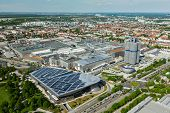 MUNICH, GERMANY - MAY 11: Aerial view of BMW Museum and BWM Welt and factory and Munich from Olympic