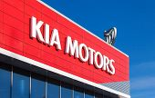 Samara, Russia - October 20: The Emblem Kia Motors On Blue Sky Background, October 20, 2013 In Samar