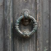 Old Doorhandle On Green Wooden Door