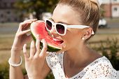 Woman Takes Watermelon. Concept Of Healthy And Dieting Food poster