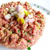 tasty Steak tartare (Raw beef) - classic steak tartare on white plate-take with mobile phone