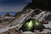 Illuminated green alpine tent  - moonlight