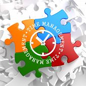 stock photo of time-piece  - Time Management with Icon of Clock Face Written on Multicolor Puzzle Pieces - JPG