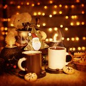 Image of beautiful Christmastime still life, traditional gingerbread with coffee cups on the table,