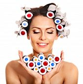 Happy beautiful woman wear hair curlers on head.