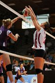 KAPOSVAR, HUNGARY - SEPTEMBER 20: Zsanett Pinter (white 2) in action at the Hungarian I. League voll